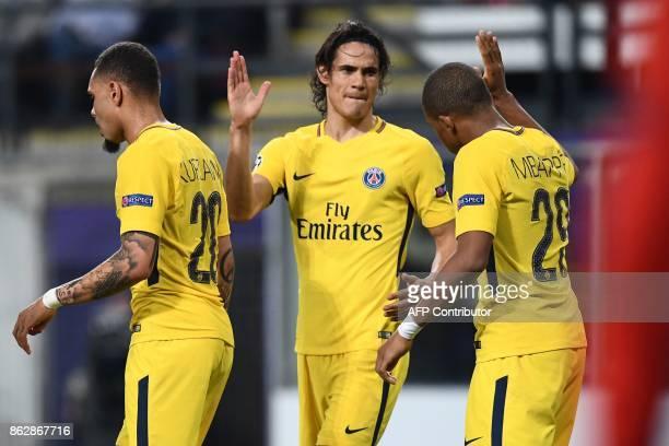 Paris SaintGermain's Uruguayan forward Edinson Cavani celebrates after scoring a goal with Paris SaintGermain's French forward Kylian Mbappe and...