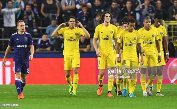 Paris SaintGermain's Uruguayan forward Edinson Cavani celebrates after scoring a goal nex to his teammates and Anderlecht's French midfielder Adrien...