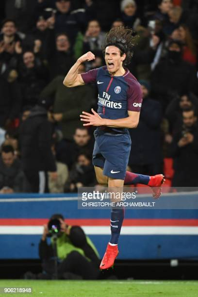 Paris SaintGermain's Uruguayan forward Edinson Cavani celebrates after scoring his team's third goal to equal the club's top scorer during the French...