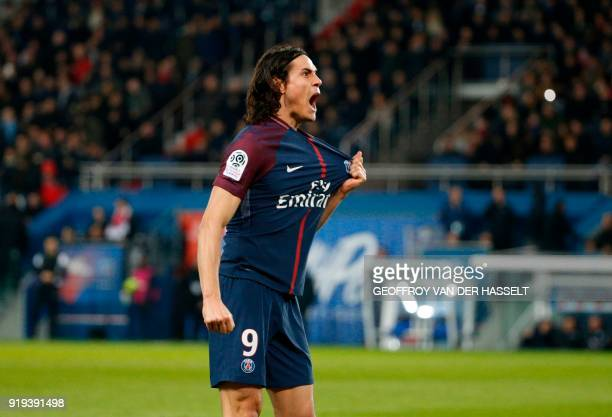 TOPSHOT Paris SaintGermain's Uruguayan forward Edinson Cavani celebrates after scoring during the French Ligue 1 football match between Paris...