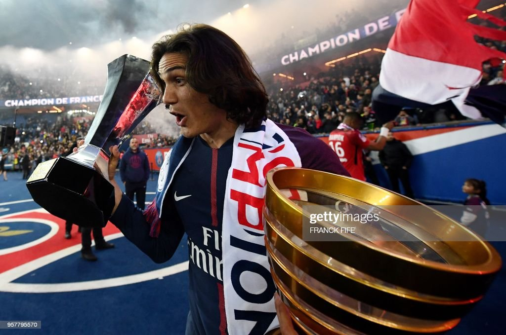 Paris Saint-Germain's Uruguayan forward Edinson Cavani celebrates after winning the French L1 title at the end of the French L1 football match Paris Saint-Germain (PSG) vs Rennes on May 12, 2018 at the Parc des Princes stadium in Paris