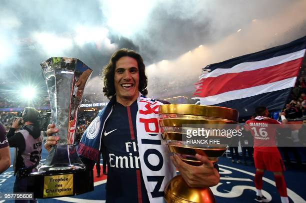 TOPSHOT Paris SaintGermain's Uruguayan forward Edinson Cavani celebrates after winning the French L1 title at the end of the French L1 football match...