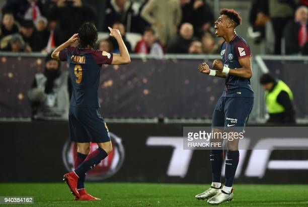 Paris SaintGermain's Uruguayan forward Edinson Cavani celebrates scoring his team's third goal with teammate French defender Presnel Kimpembe during...