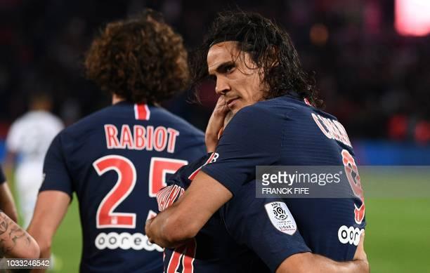 Paris Saint-Germain's Uruguayan forward Edinson Cavani celebrates with teammates after scoring a penalty kick during the French L1 football match...