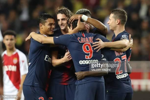 TOPSHOT Paris SaintGermain's Uruguayan forward Edinson Cavani celebrates with teammates after scoring during the French L1 football match Monaco vs...