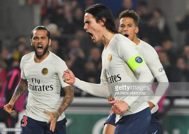 Paris Saint-Germain's Uruguayan forward Edinson Cavani celebrates with teammates after scoring a goal during the French L1 football match between...