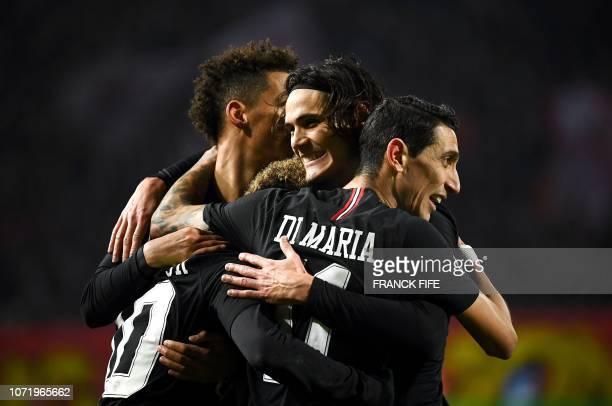 TOPSHOT Paris SaintGermain's Uruguayan forward Edinson Cavani celebrates with teammates after scoring a goal during the European Champions League...