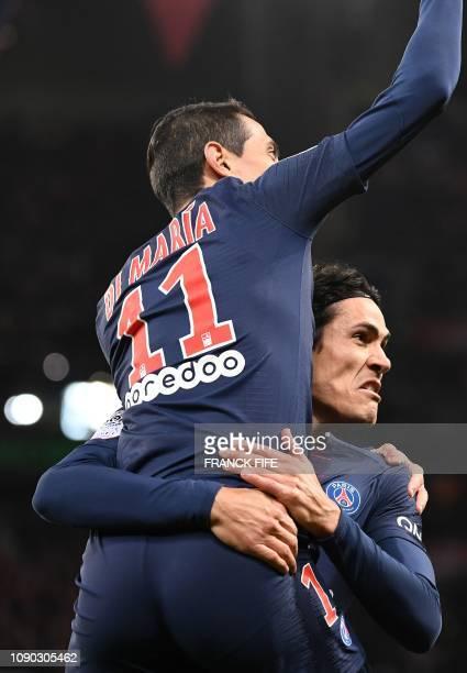 Paris Saint-Germain's Uruguayan forward Edinson Cavani celebrates with Paris Saint-Germain's Argentine midfielder Angel Di Maria after scoring a goal...