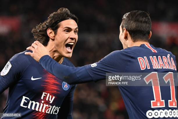 TOPSHOT Paris SaintGermain's Uruguayan forward Edinson Cavani celebrates with Paris SaintGermain's Argentine midfielder Angel Di Maria after scoring...