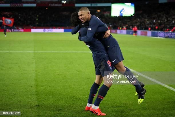 Paris Saint-Germain's Uruguayan forward Edinson Cavani celebrates with Paris Saint-Germain's French forward Kylian Mbappe after scoring a goal during...