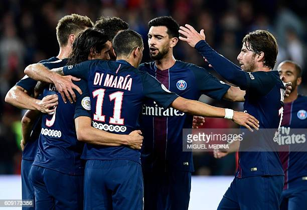 Paris SaintGermain's Uruguayan forward Edinson Cavani celebrates with teammates after scoring a penalty during the French L1 football match between...