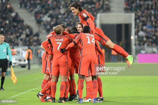 TOPSHOT Paris SaintGermain's Uruguayan forward Edinson Cavani celebrates with teammates after scoring a goal during the French League Cup football...