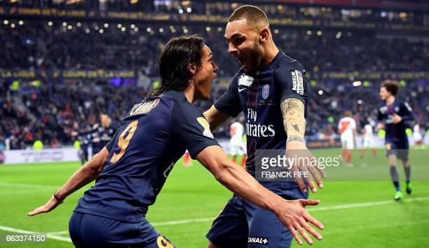 TOPSHOT Paris SaintGermain's Uruguayan forward Edinson Cavani celebrates with Paris SaintGermain's French defender Layvin Kurzawa after scoring a...