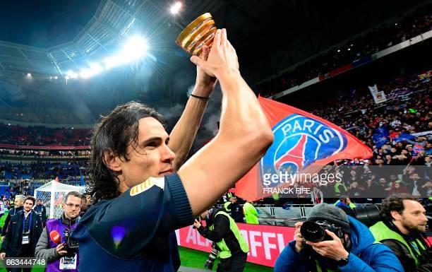TOPSHOT Paris SaintGermain's Uruguayan forward Edinson Cavani celebrates with teammates after winning the French League Cup final football match...