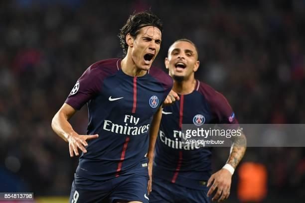 Paris SaintGermain's Uruguayan forward Edinson Cavani celebrates with Paris SaintGermain's French defender Layvin Kurzawa after scoring a goal during...