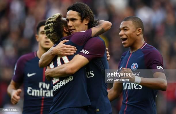 Paris SaintGermain's Uruguayan forward Edinson Cavani celebrates with Paris SaintGermain's Brazilian striker Neymar and Paris SaintGermain's French...