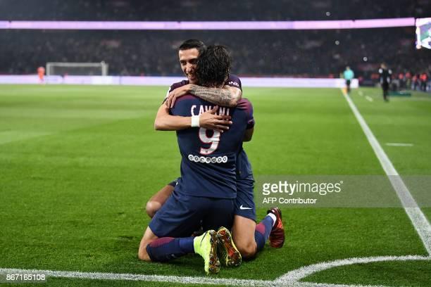 Paris SaintGermain's Uruguayan forward Edinson Cavani celebrates with Paris SaintGermain's Argentinian midfielder Angel Di Maria after scoring a goal...
