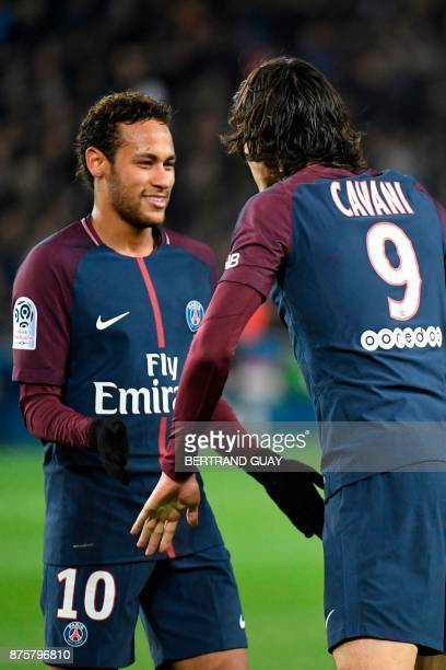 Paris SaintGermain's Uruguayan forward Edinson Cavani celebrates with Paris SaintGermain's Brazilian forward Neymar after Cavani opened the scoring...