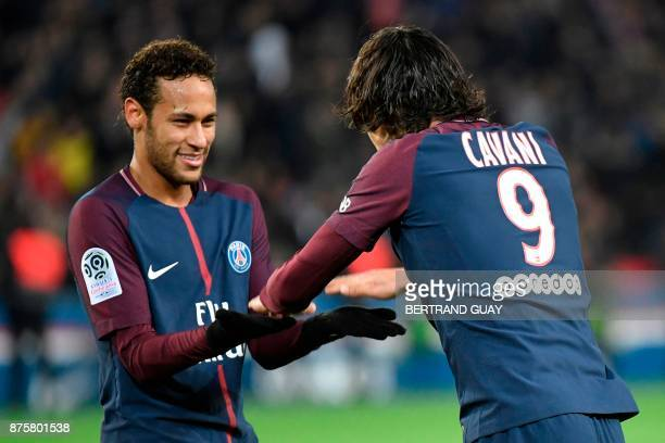 Paris SaintGermain's Uruguayan forward Edinson Cavani celebrates with Paris SaintGermain's Brazilian forward Neymar after opening the scoring during...