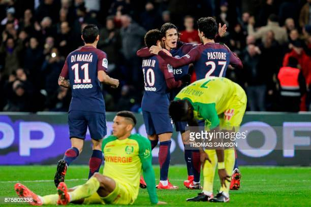 Paris SaintGermain's Uruguayan forward Edinson Cavani celebrates with Paris SaintGermain's Argentinian forward Angel Di Maria Paris SaintGermain's...