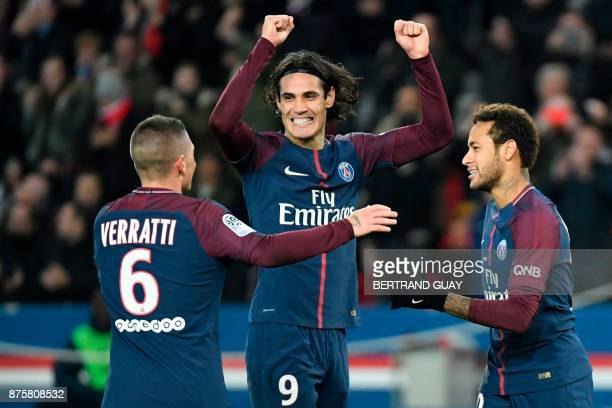 Paris SaintGermain's Uruguayan forward Edinson Cavani celebrates with Paris SaintGermain's Italian midfielder Marco Verratti and Paris SaintGermain's...