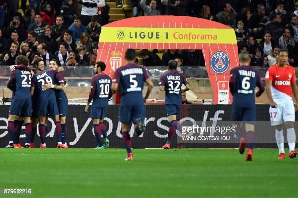 Paris SaintGermain's Uruguayan forward Edinson Cavani celebrates with teammates after scoring a goal during the French L1 football match between...