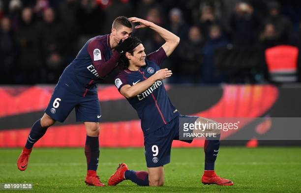 Paris SaintGermain's Uruguayan forward Edinson Cavani celebrates with Paris SaintGermain's Italian midfielder Marco Verratti after scoring a goal...