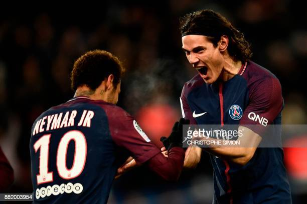 TOPSHOT Paris SaintGermain's Uruguayan forward Edinson Cavani celebrates with Paris SaintGermain's Brazilian forward Neymar after scoring a goal...
