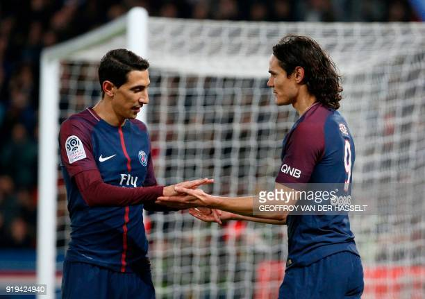 Paris SaintGermain's Uruguayan forward Edinson Cavani celebrates with Paris SaintGermain's Argentinian forward Angel Di Maria after scoring during...