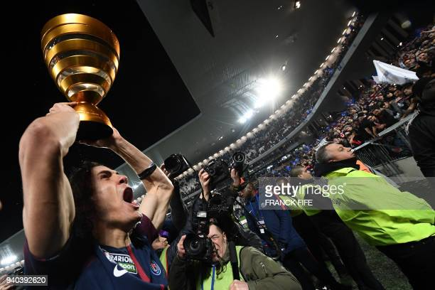 Paris SaintGermain's Uruguayan forward Edinson Cavani celebrates with the trophy after victory in the French League Cup final football match between...