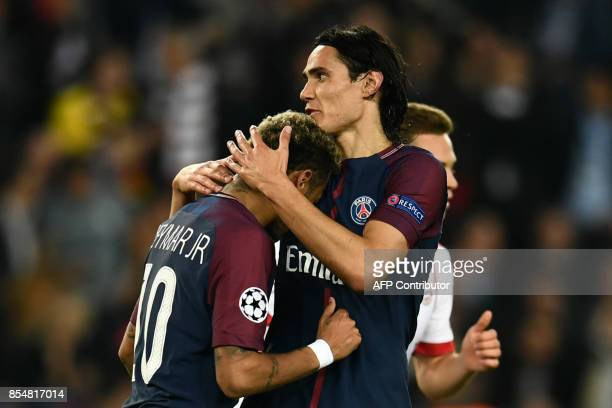 Paris SaintGermain's Uruguayan forward Edinson Cavani comforts Paris SaintGermain's Brazilian forward Neymar during the UEFA Champions League...