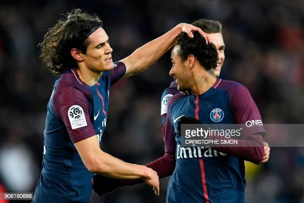 Paris SaintGermain's Uruguayan forward Edinson Cavani congratulates Paris SaintGermain's Brazilian forward Neymar after he scored a freekick during...