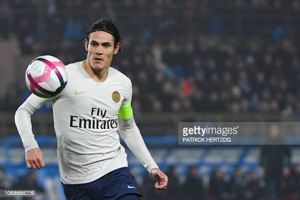 Paris SaintGermain's Uruguayan forward Edinson Cavani eyes the ball during the French L1 football match between Strasbourg and Paris SaintGermain at...