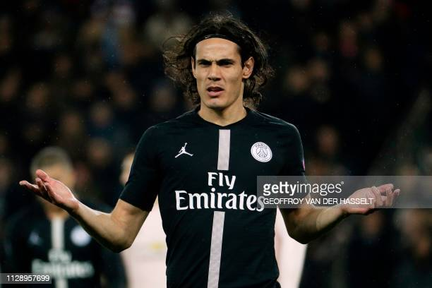 Paris SaintGermain's Uruguayan forward Edinson Cavani gestures during the UEFA Champions League round of 16 secondleg football match between Paris...