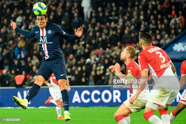 Paris Saint-Germain's Uruguayan forward Edinson Cavani heads the ball during the French L1 football match between Paris Saint-Germain and AS Monaco...