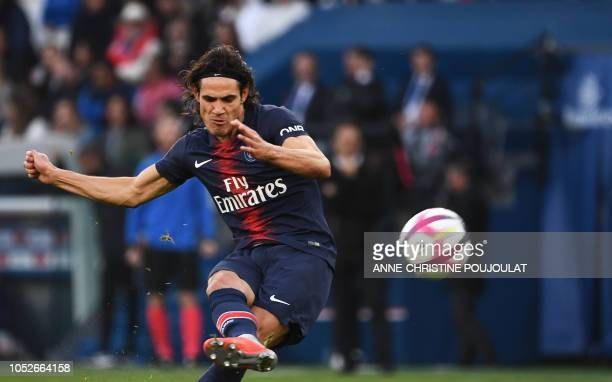 Paris SaintGermain's Uruguayan forward Edinson Cavani hits the ball on October 20 2018 at the Parc des Princes stadium in Paris during the French L1...