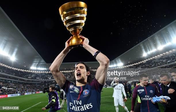 TOPSHOT Paris SaintGermain's Uruguayan forward Edinson Cavani holds his trophy after winning the French League Cup final football match between...