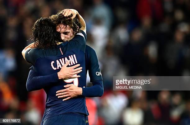 TOPSHOT Paris SaintGermain's Uruguayan forward Edinson Cavani hugs with Paris SaintGermain's French midfielder Adrien Rabiot during the French L1...