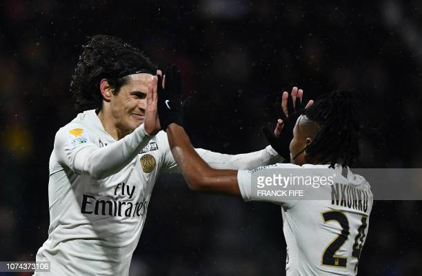 Paris SaintGermain's Uruguayan forward Edinson Cavani is congratulated by Paris SaintGermain's French midfielder Christopher Nkunku after scoring a...