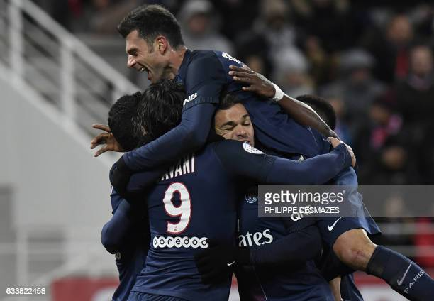 Paris SaintGermain's Uruguayan forward Edinson Cavani is congratulated by teammates after scoring during the French L1 football match between Dijon...