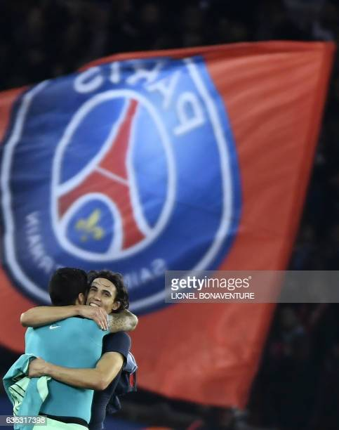 Paris SaintGermain's Uruguayan forward Edinson Cavani is congratulated by Barcelona's Uruguayan forward Luis Suarez after he scored a goal during the...
