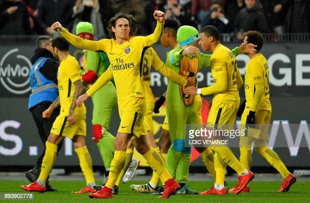 Paris SaintGermain's Uruguayan forward Edinson Cavani is congratulated by teammates after scoring a goal during the French L1 football match between...
