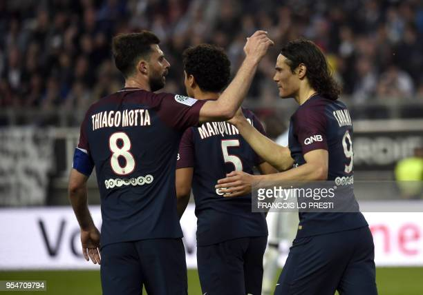 Paris SaintGermain's Uruguayan forward Edinson Cavani is congratulated by teammates after scoring during the French L1 football match between Amiens...