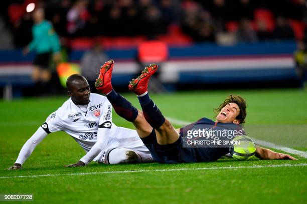 Paris SaintGermain's Uruguayan forward Edinson Cavani is fouled by Dijon's French defender Cedric Yambere during the French L1 football match between...