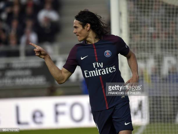 Paris SaintGermain's Uruguayan forward Edinson Cavani jubilates after scoring during the French L1 football match between Amiens and PSG on May 4...