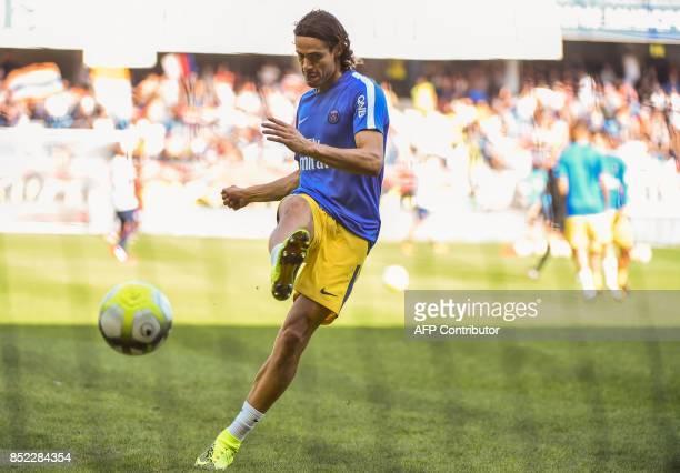 Paris SaintGermain's Uruguayan forward Edinson Cavani kicks the ball as he trains prior to the French Ligue 1 football match between Montpellier and...