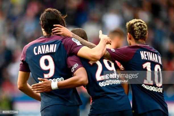 TOPSHOT Paris SaintGermain's Uruguayan forward Edinson Cavani Paris SaintGermain's French forward Kylian Mbappe and Paris SaintGermain's Brazilian...