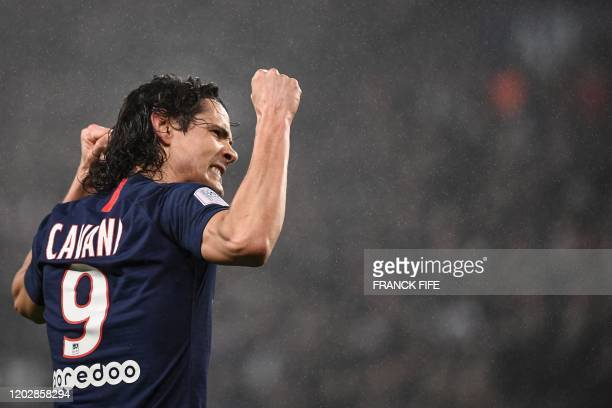 Paris Saint-Germain's Uruguayan forward Edinson Cavani reacts after scoring a goal during the French L1 football match between Paris Saint-Germain...
