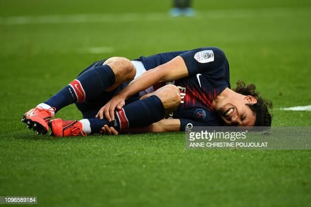 TOPSHOT Paris SaintGermain's Uruguayan forward Edinson Cavani reacts after he gets an injury during the French L1 football match between Paris...