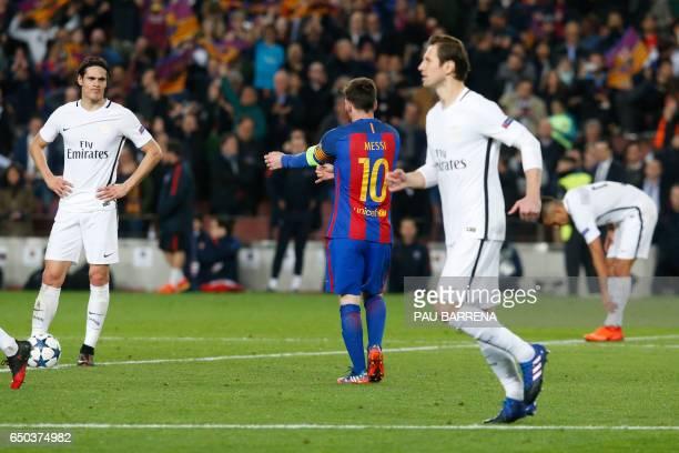 Paris SaintGermain's Uruguayan forward Edinson Cavani reacts after Barcelona's Argentinian forward Lionel Messi scored during the UEFA Champions...